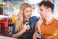 beautiful couple smiling, hugging and drinking soda at cafe - PhotoDune Item for Sale