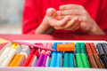 Partial view of schoolchild playing with colorful plasticine - PhotoDune Item for Sale