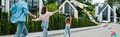 panoramic shot of kid running with colorful kite near parents on street - PhotoDune Item for Sale
