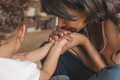 close up view of mother holding daughter's hands - PhotoDune Item for Sale