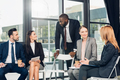 multicultural businesspeople having meeting in conference hall - PhotoDune Item for Sale