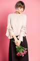 Young attractive woman in fashionable clothes posing with bouquet of bright flowers - PhotoDune Item for Sale