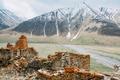 Fortress On Mountain Background Near Karatkau Village, Kazbegi District, Mtskheta-Mtianeti Region - PhotoDune Item for Sale