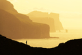 Man silhouette on background of famous Risin og Kellingin rocks - PhotoDune Item for Sale
