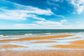 Tide waves on tropical beach sand and blue ocean - PhotoDune Item for Sale
