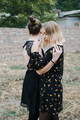 LGBT Lesbian couple love moments concept. Two Young lesbians girls hugging and walking outdoors - PhotoDune Item for Sale