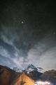 Stepantsminda, Georgia. Night Starry Sky With Glowing Stars Above Peak Of Mount Kazbek Covered With - PhotoDune Item for Sale