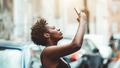 Black girl taking pics outdoors - PhotoDune Item for Sale