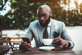 Elegant black guy phoning in a cafe - PhotoDune Item for Sale