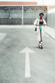Black girl riding e-scooter outdoors - PhotoDune Item for Sale