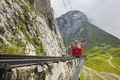 Cogwheel train passing mountain landscape of Swiss Alps - PhotoDune Item for Sale