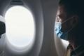 Man wearing face mask inside airplane during flight - PhotoDune Item for Sale