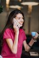 Slender slim brunette girl talking on the cell phone in cafe. Body health, slimness, self-love - PhotoDune Item for Sale