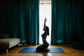 Young woman practicing yoga at home. meditation practice - PhotoDune Item for Sale
