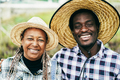 African farmers smiling on camera during harvest period - PhotoDune Item for Sale
