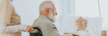 Senior man after stroke sits in a wheelchair at a nursing home - PhotoDune Item for Sale