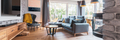 Elegant living room with light wooden floor, grey couch and wing back chair and big tv on the wall - PhotoDune Item for Sale