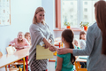 Young teacher and student in the classroom during the first maths lesson - PhotoDune Item for Sale