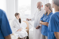 Bright hospital room with helpful doctors and ill patient - PhotoDune Item for Sale