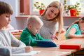 Young pretty teacher solves homework together with the student - PhotoDune Item for Sale