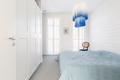 Stylish modern white and blue chandelier in trendy spacious bedroom with king size bed - PhotoDune Item for Sale