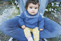 Little baby portrait sitting on his dad legs - PhotoDune Item for Sale
