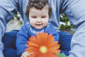 Little baby discovering a huge flower for first time - PhotoDune Item for Sale