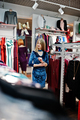 Blonde girl in blue dress in the clothing store boutique. - PhotoDune Item for Sale
