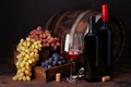 Wine bottles, grapes, glass of red wine and old barrel - PhotoDune Item for Sale