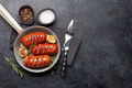Hot grilled sausages in a frying pan - PhotoDune Item for Sale