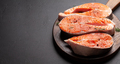 Fresh raw salmon cooking. Fish steaks with herbs and spices - PhotoDune Item for Sale