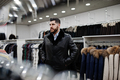 Stylish turkish man at the store of fur coats and leather jackets. Successful arabian beard man. - PhotoDune Item for Sale