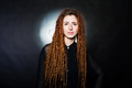 Studio shoot of girl in black with dreads at black background. - PhotoDune Item for Sale