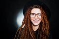 Studio shoot of girl in black with dreads, hat and glasses at black background. - PhotoDune Item for Sale