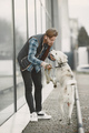 Man with a dog in a city - PhotoDune Item for Sale