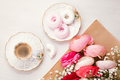 Top view to pink flowers and coffee - PhotoDune Item for Sale