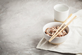 Assorted multi-colored wild rice in ceramic bowl and chopsticks with goblet of water - PhotoDune Item for Sale