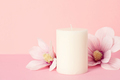 Delicate flower scented candle over pastel pink background with copy space - PhotoDune Item for Sale