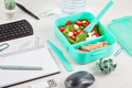 Take away lunch box with fresh salad and tuna fish over the office desk with office supplies - PhotoDune Item for Sale