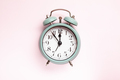 Retro style alarm clock over the pink background - PhotoDune Item for Sale