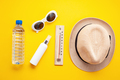 Essential accessories for summer heat: sunglasses, hat, sunscreen, bottle of water. Flat lay, top - PhotoDune Item for Sale