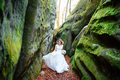 Beautiful blonde bride is spinning in a narrow gorge. - PhotoDune Item for Sale