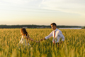 Bride and groom in a wheat field. A woman leads a man by the hand. - PhotoDune Item for Sale