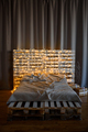 Modern interior. The bed is made from pallets, decorated with garlands and gifts. - PhotoDune Item for Sale