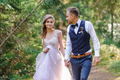 An attractive newlywed couple, a happy and joyful moment. - PhotoDune Item for Sale