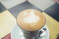 coffee latte art in cafe, vintage filter image - PhotoDune Item for Sale