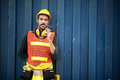foreman worker smoking cigarettes with the background of container wall, work hard concept - PhotoDune Item for Sale