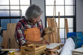 A carpenter is making crafts from wood. - PhotoDune Item for Sale