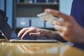 Man holding credit card and using laptop - PhotoDune Item for Sale