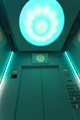 Interior of a futuristic elevator with green light - PhotoDune Item for Sale